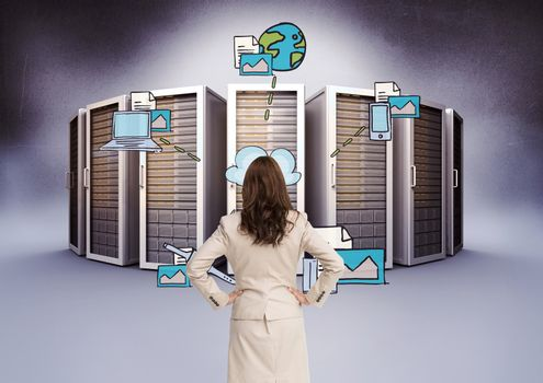 Businesswoman Standing looking at Graphic against data base background