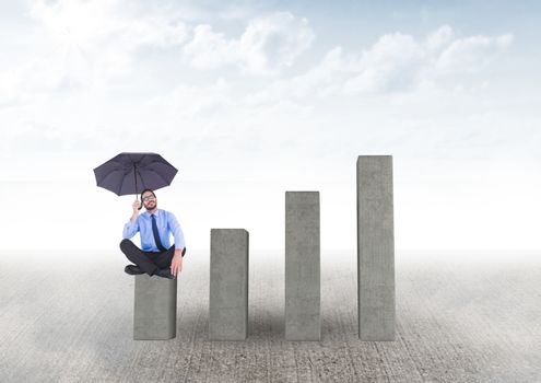 Businessman seating with an umbrella on graph against grey background