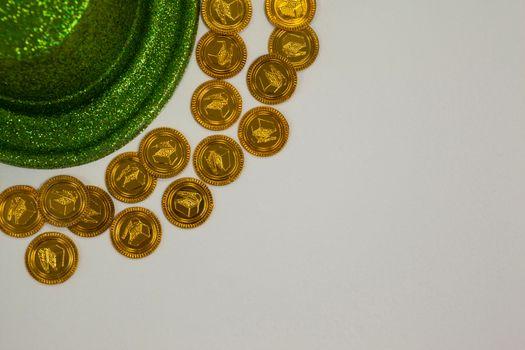 St Patricks Day leprechaun hat surround with gold chocolate coins