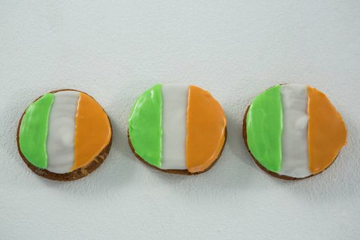 St. Patricks Day three cookies with irish flag toppings on white background