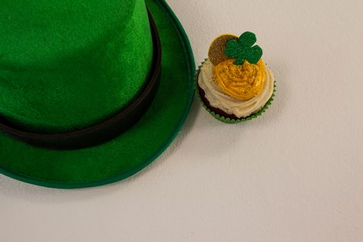 St Patricks Day leprechaun hat with shamrock on cupcake