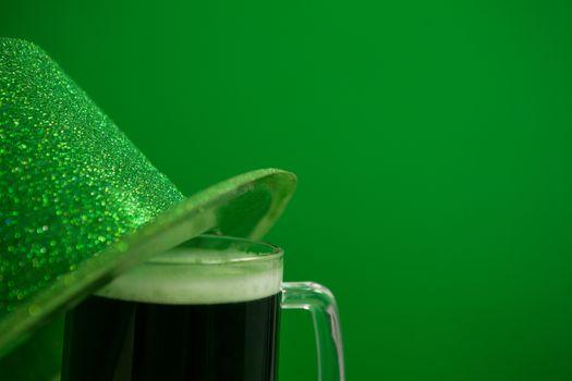 St Patricks Day leprechaun hat with mug of green beer
