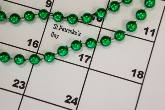 St. Patricks Day close-up of beads kept on calendar