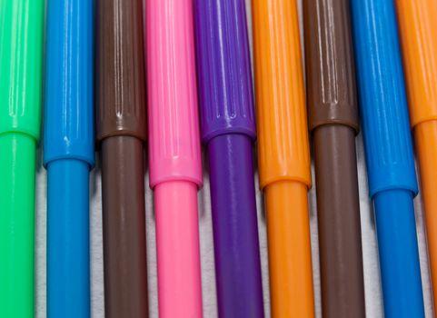 Sketch pens arranged in a row