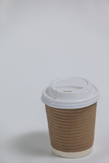 Disposable coffee cup on white background