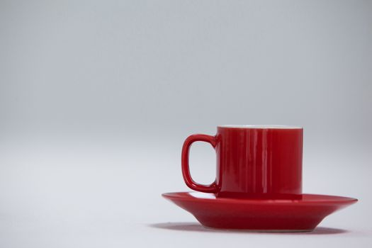 Close-up red coffee cup and saucer