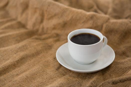 Black coffee served on sack
