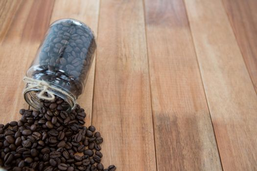 Coffee beans spilling out of jar