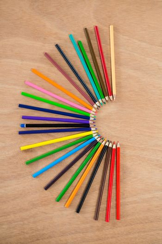 Colored pencils arranged in semi circle
