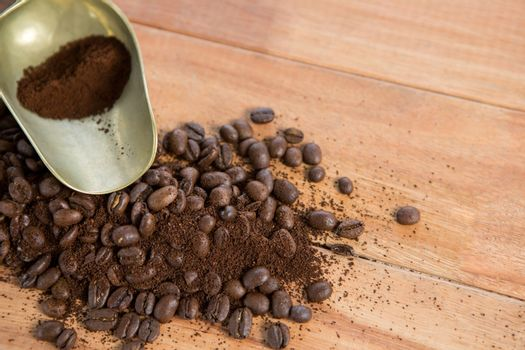 Coffee beans with powder and scoop