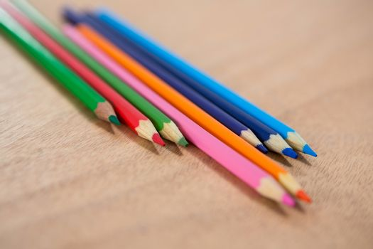 Colored pencils arranged in diagonal line
