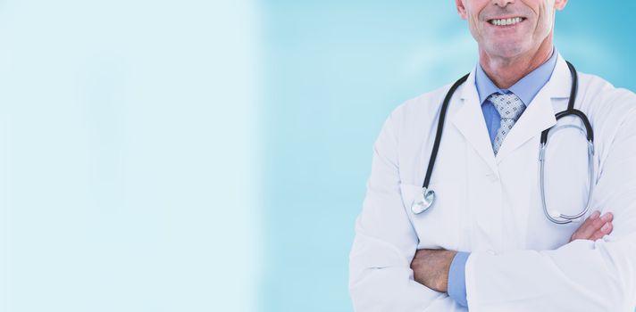 Portrait of confident male doctor against dental equipment