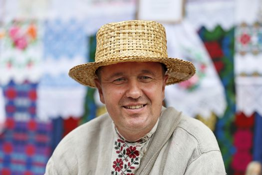 Slavic man in a straw hat