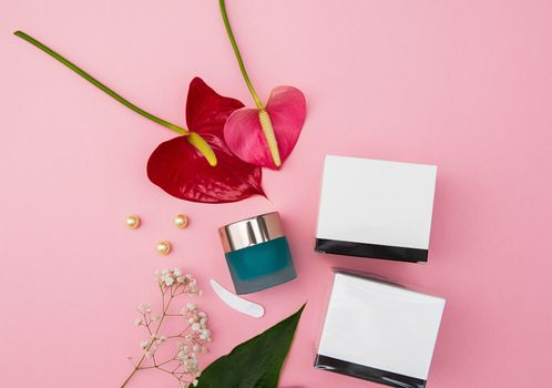 Makeup cosmetic products on vivid color background, flat lay top view.