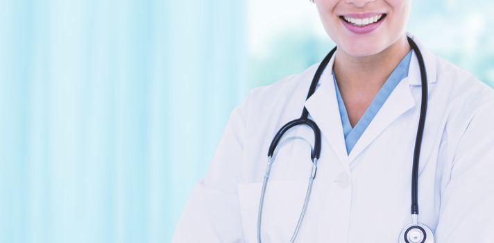 Portrait of beautiful female doctor smiling against dental equipment