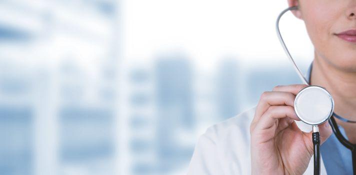Close-up of female doctor holding stethoscope against dental equipment