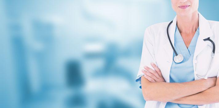 Beautiful doctor standing arms crossed against dental equipment