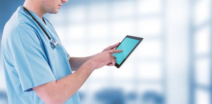 Surgeon using futuristic digital tablet against dental equipment