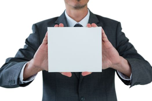 Businessman holding blank placard