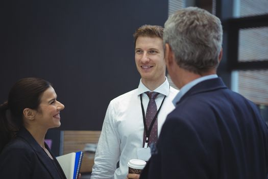 Businesspeople interacting with each other