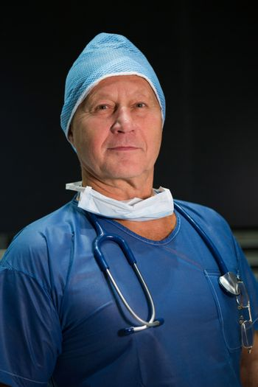 Portrait of male surgeon in scrubs