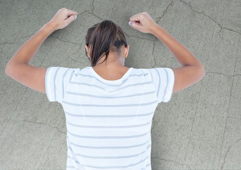 Angry grief struck young woman banging wall with cracks
