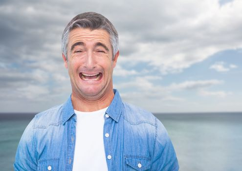 Man crying against sea
