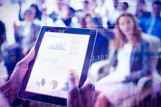 Businessperson using digital tablet during meeting