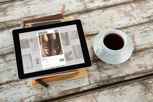 Overhead of tablet on desk against composite image of website page