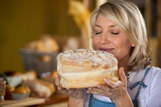 Female staff smelling a sweet food