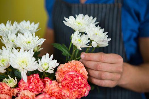 Florist holding flowers in florist shop