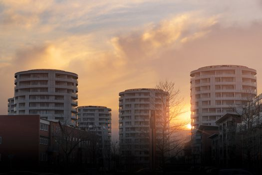 Round tower appartments in the sunset rising up in the city