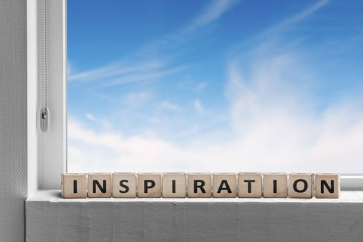 Inspiration message in a windows sill with blue sky outside