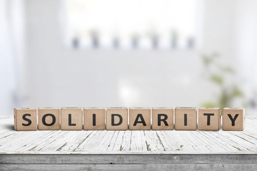 Solidarity message on a wooden table