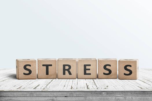 The word stress on a sign made of wooden blocks in a bright room on a table