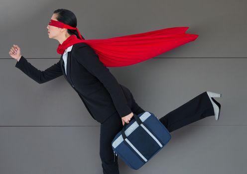 Business Superhero against wood