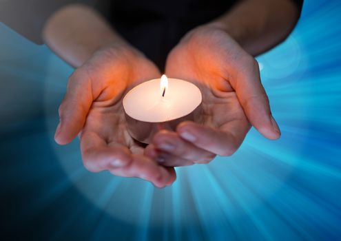 Hands holding candle hopeful and helpful