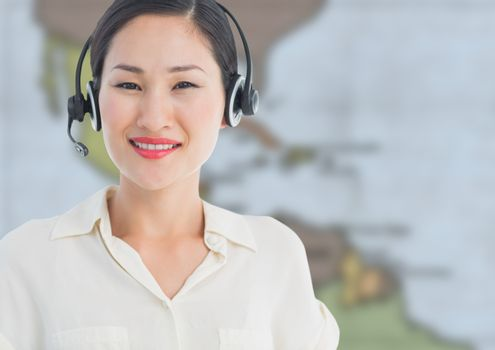 Digital composite of Travel agent with headset against blurry map