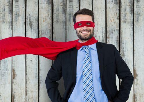 Superhero businessman against wood