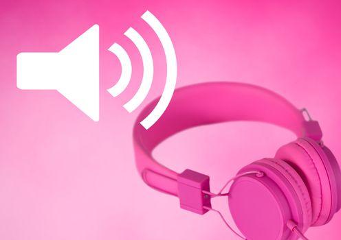 Pink headphones with volume speaker icon