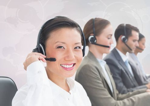 Digital composite of Travel agents with headsets against white map