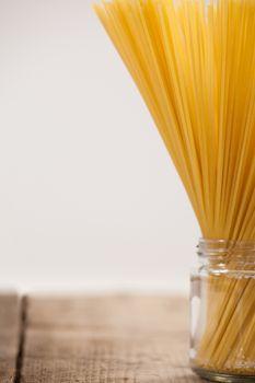 Bundle of raw spaghetti in glass jar