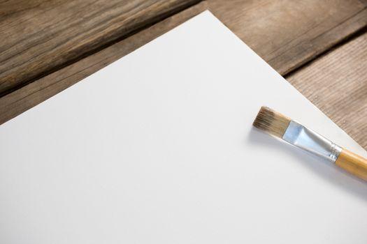 Paintbrush on blank paper