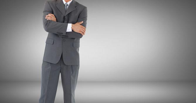 Businessman torso against grey vignette