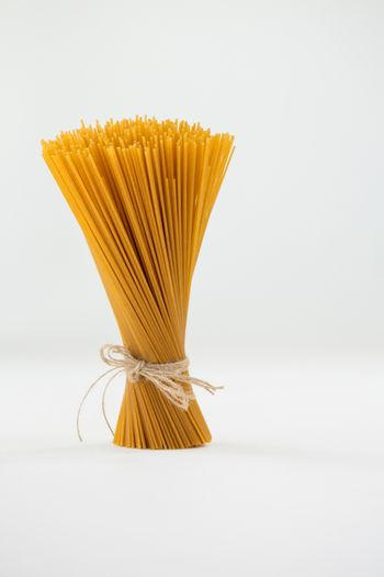 Bundle of raw spaghetti tied with rope