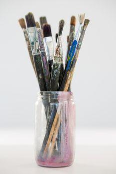 Various paintbrush in a jar