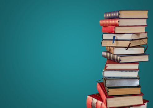 Pile of books against teal background