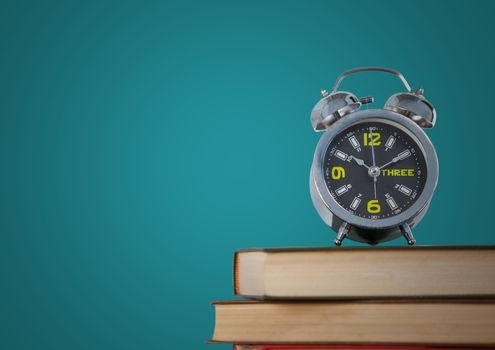Pile of books with clock against teal background