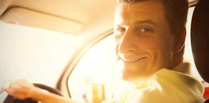 Man sitting in car at new showroom