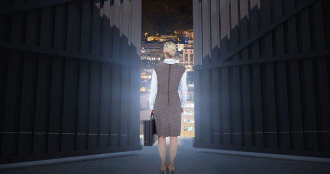 Composite image of back turned businesswoman holding a briefcase 3d